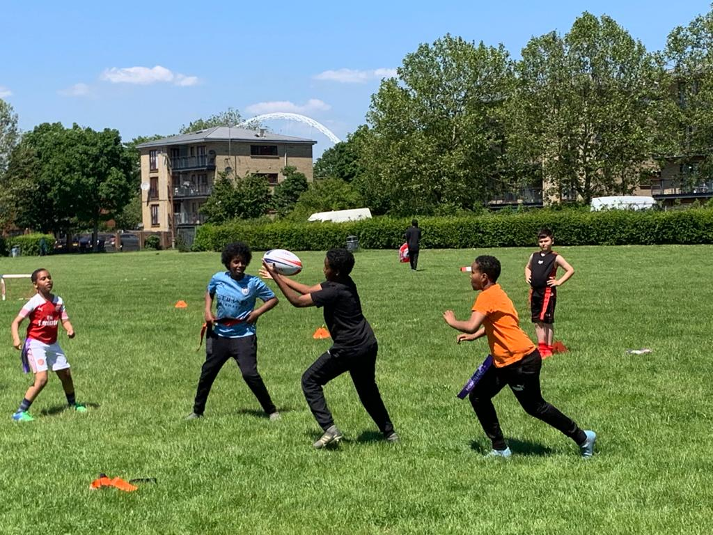 Children playing tag rugby
